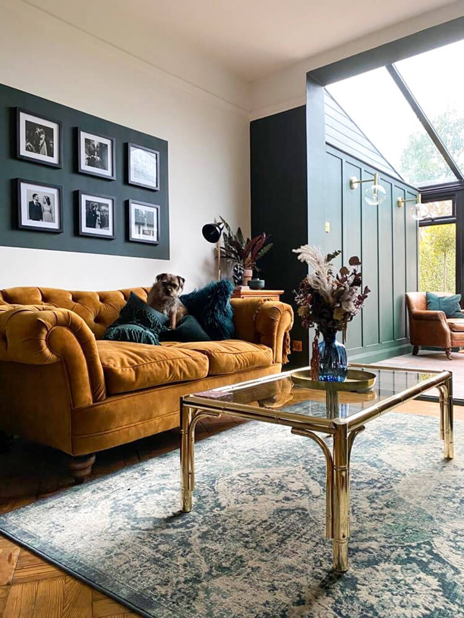 Open plan living room with dark mustard sofa