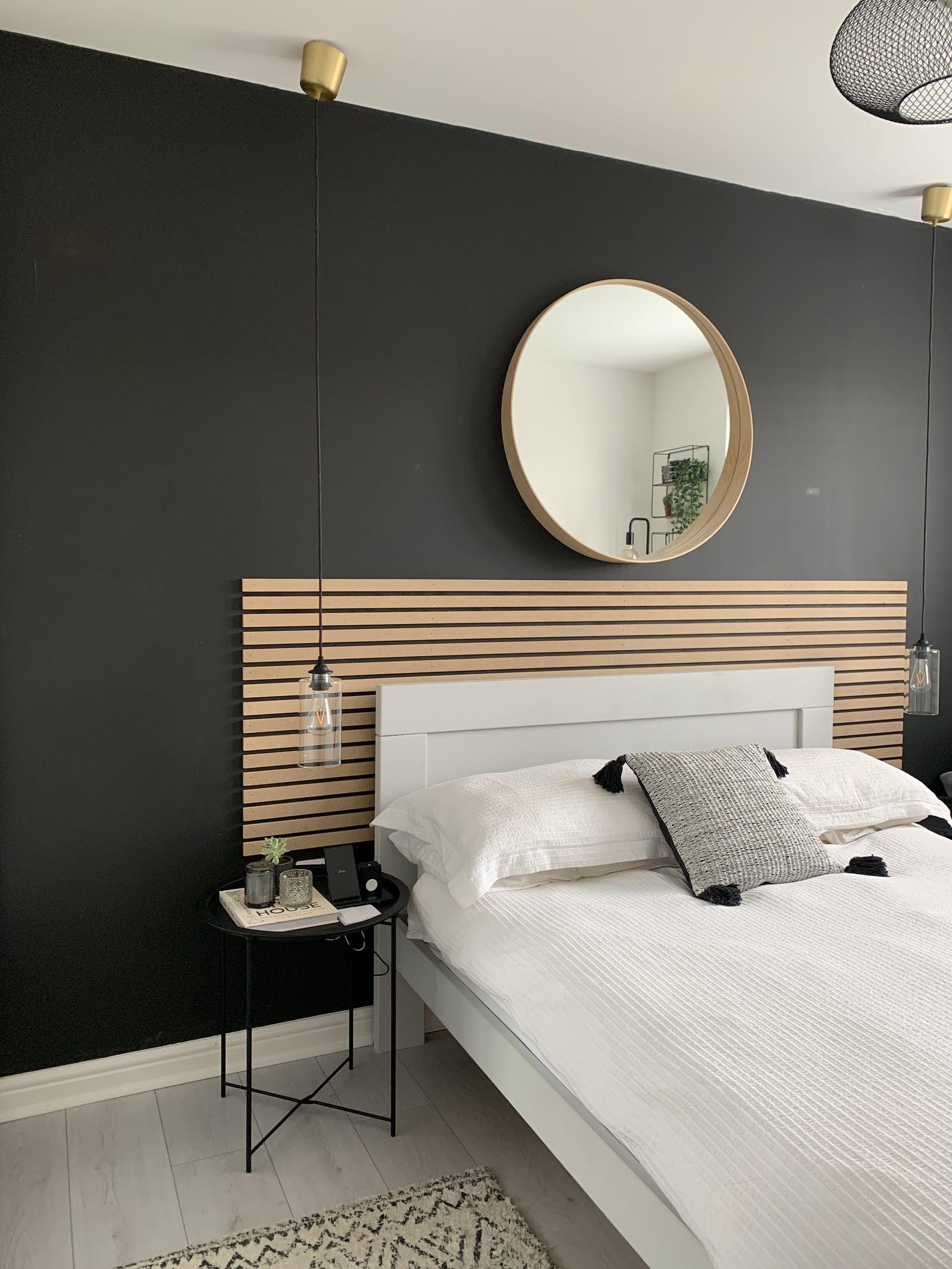 Bedroom with black walls and white bedding