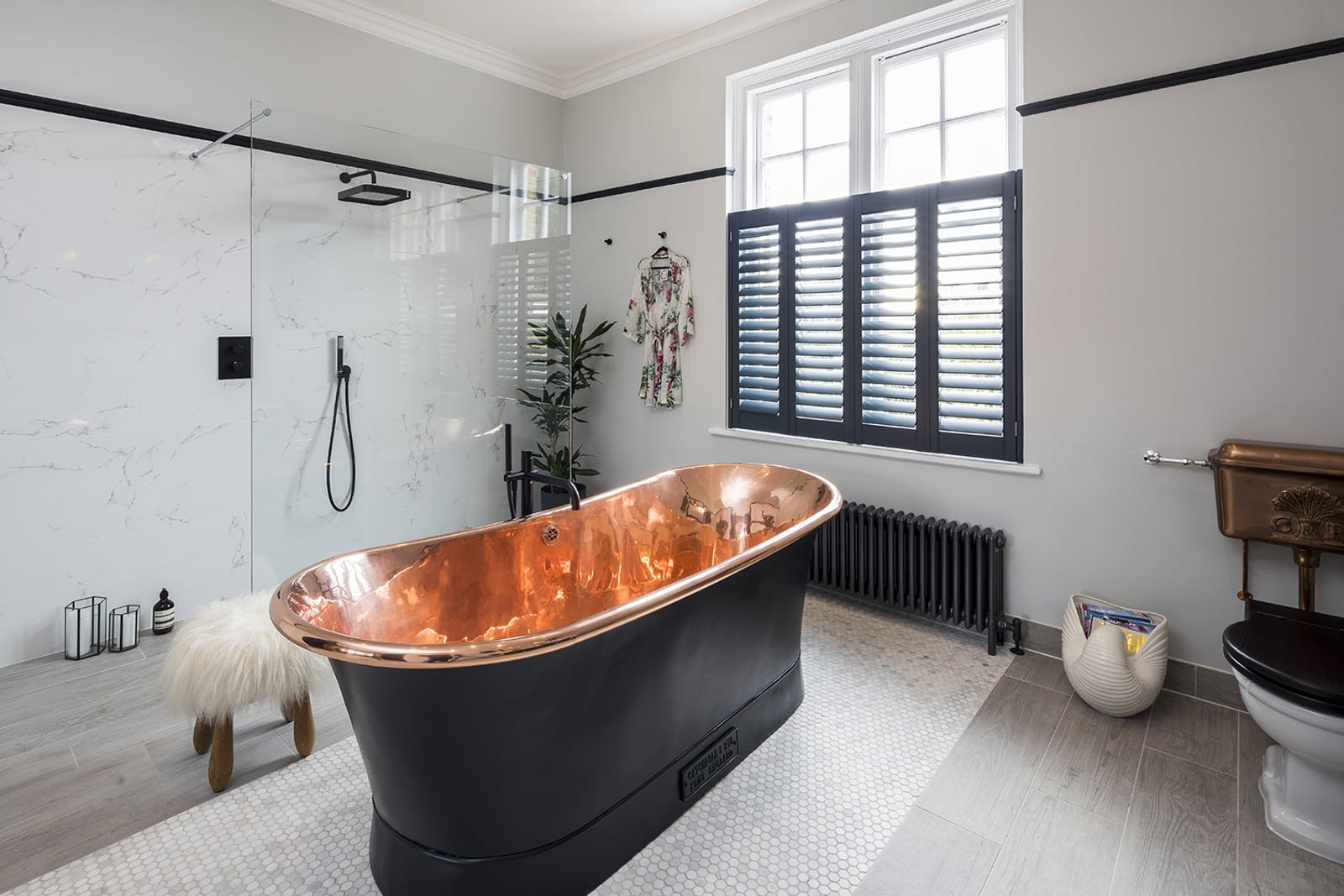 Master bathroom with a black bathtub