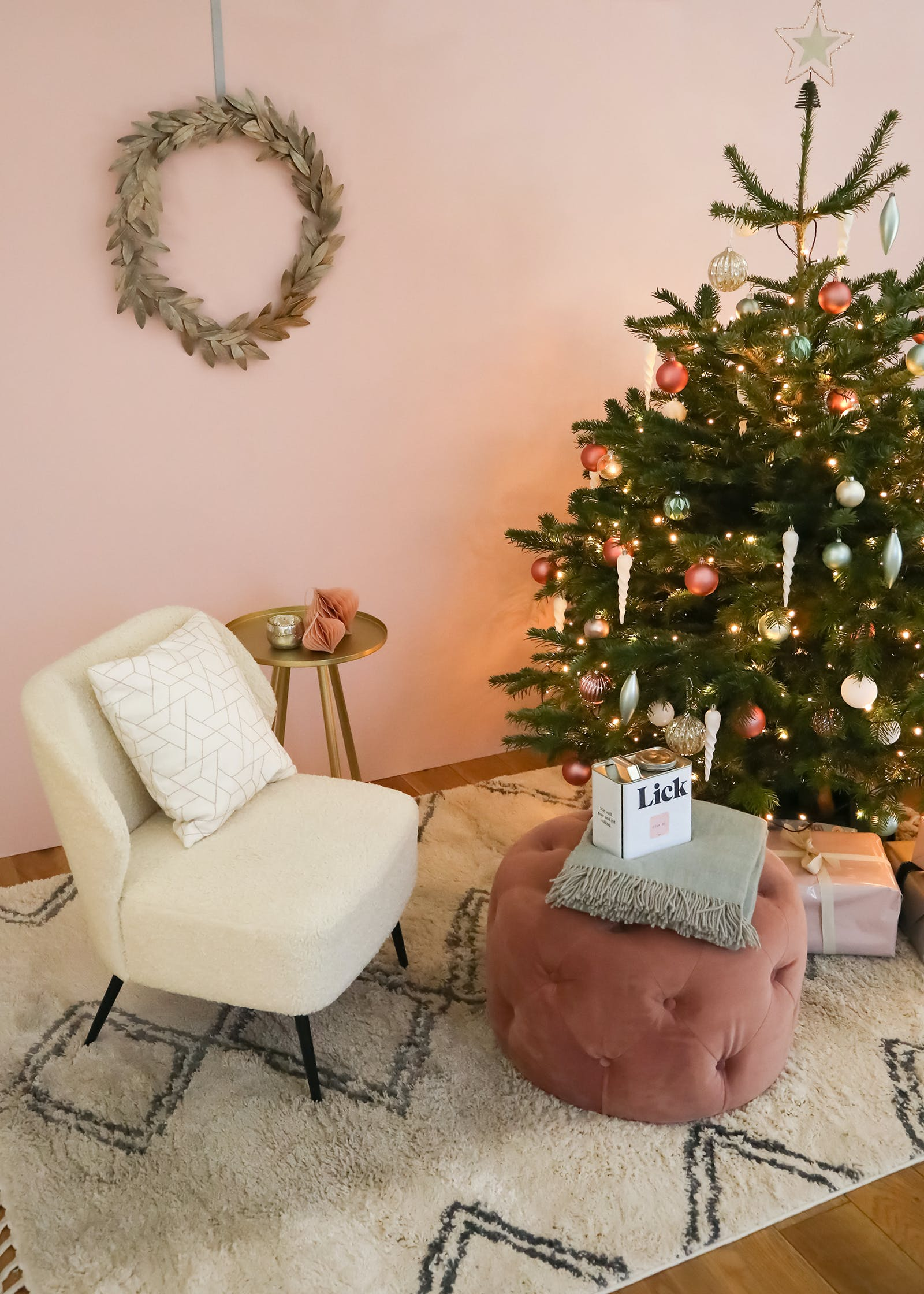 Christmas tree decorated in pastel coloured baubles against Lick Pink 03 wall