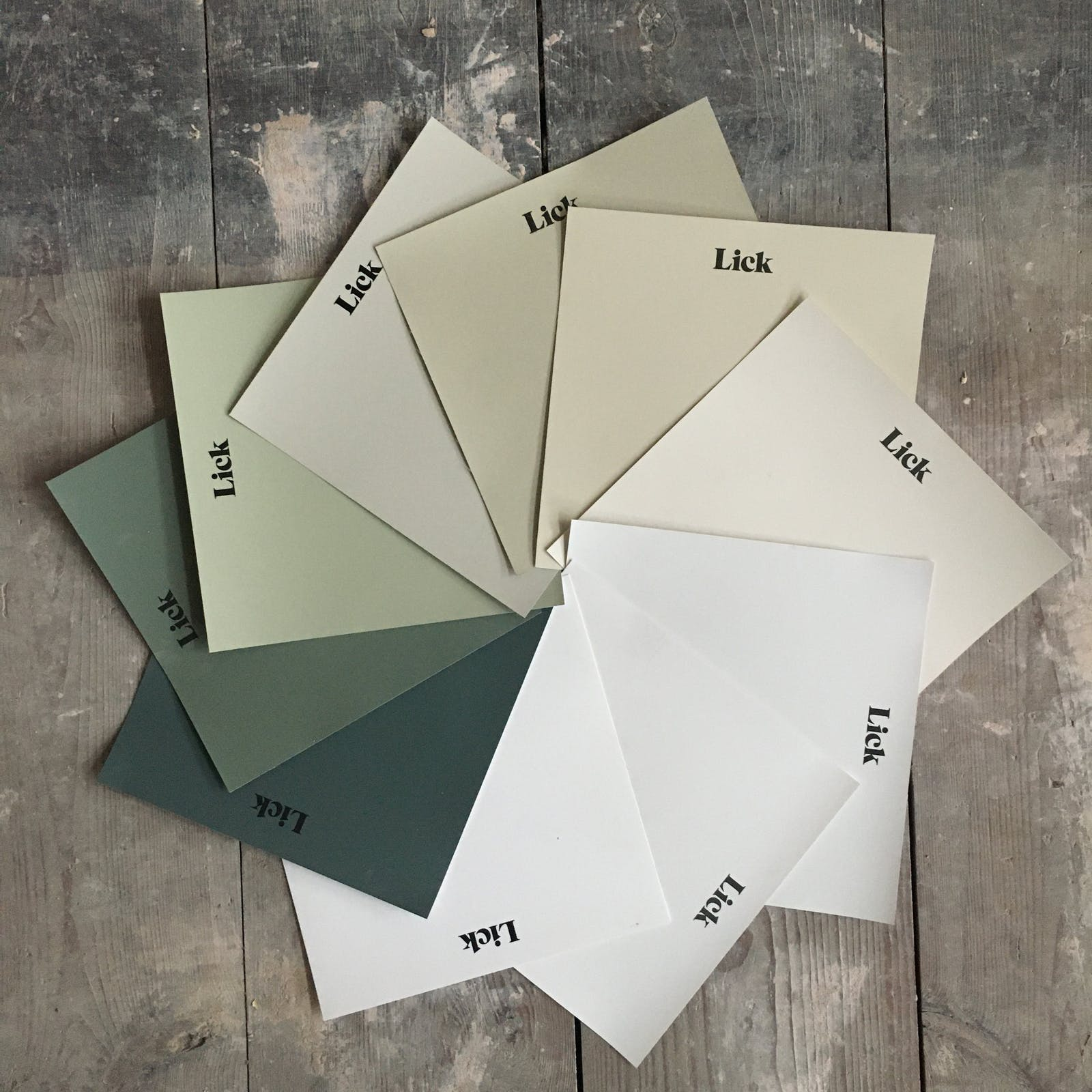 A display of Lick Green and White paint samples