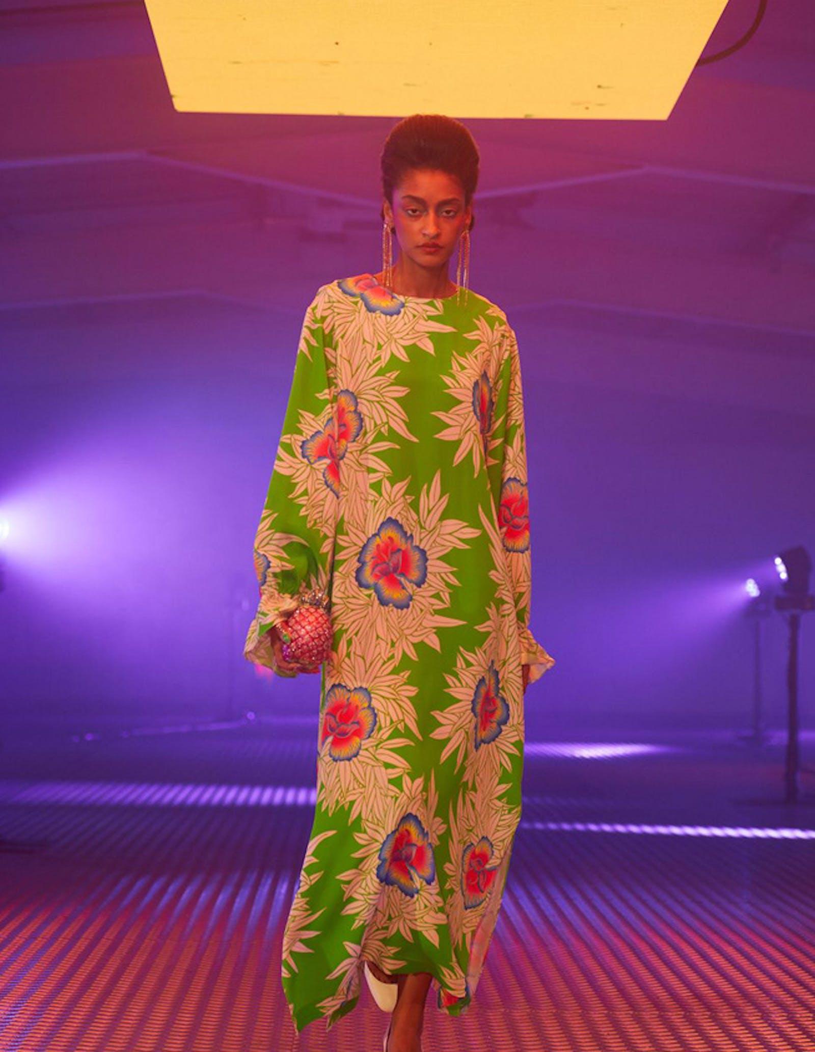 London fashion week shot of woman wearing floral exotic flower print on her dress