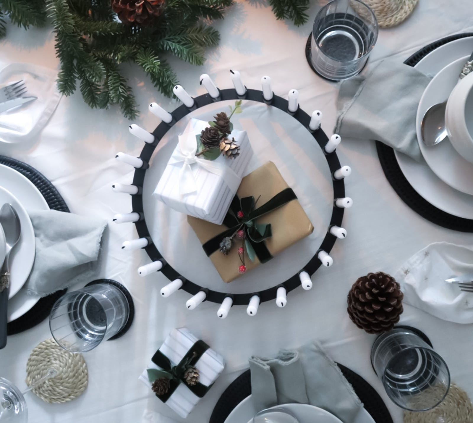 Flat lay table decoration with glasses, napkins and Christmas accents