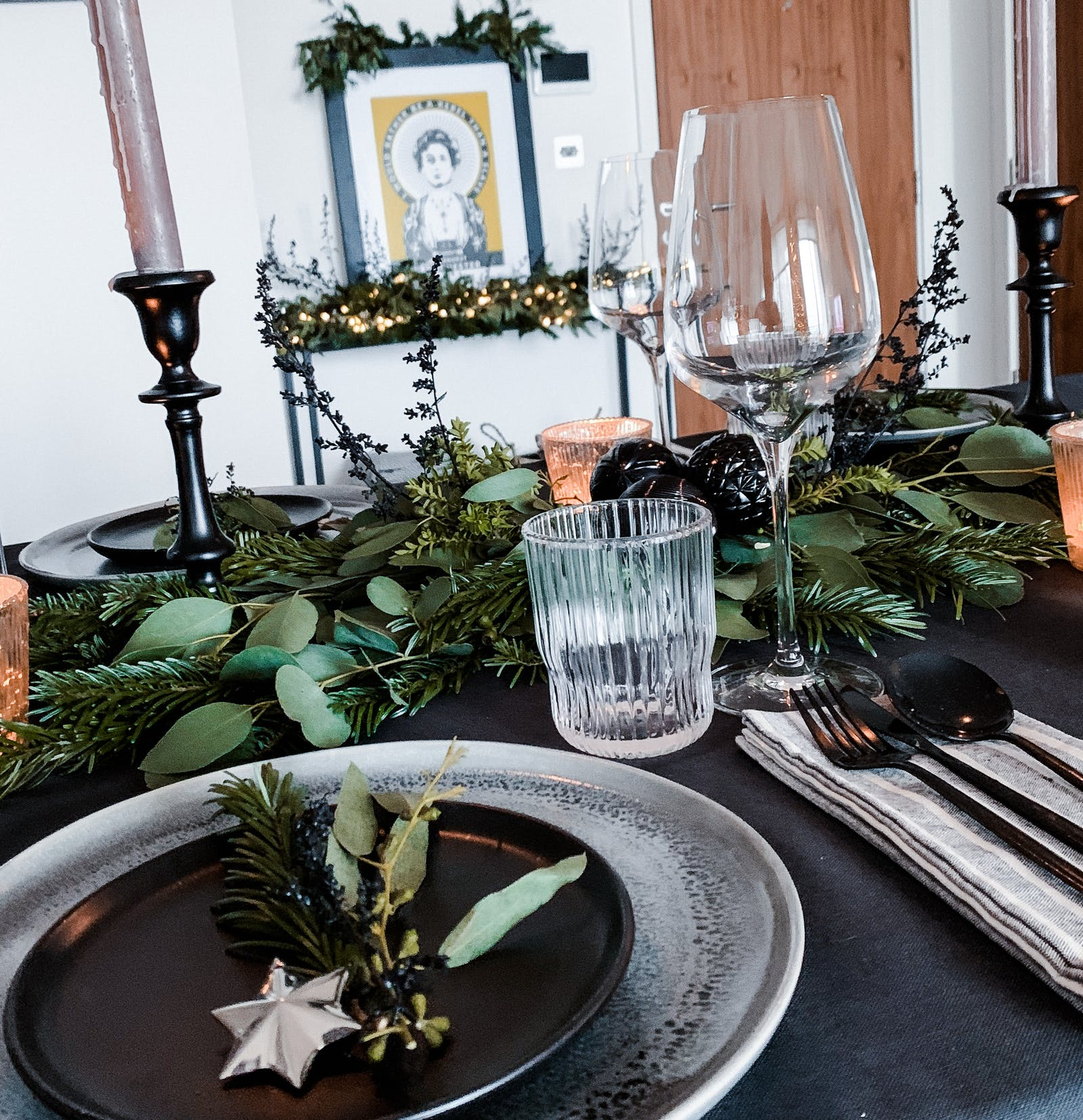 Table decked with fresh foliage, glasses and plates
