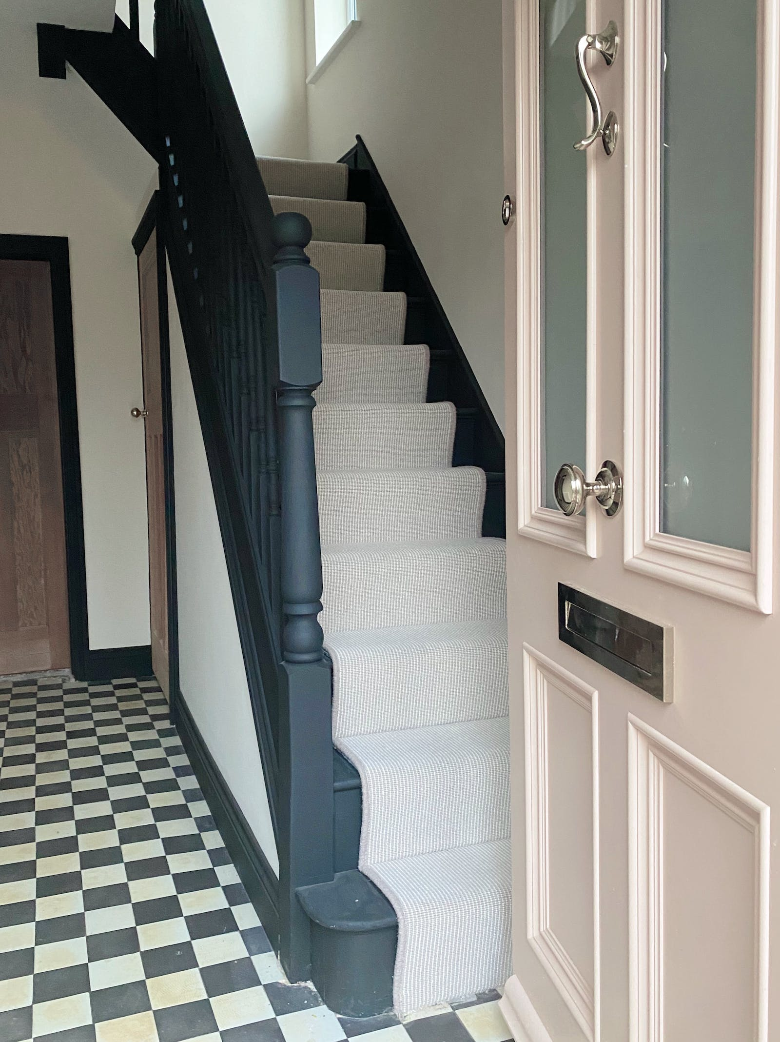 Image of entrance hall freshly painted with monochrome themed stairs