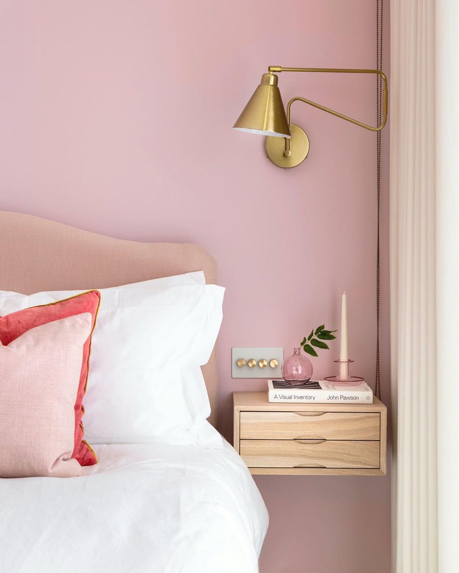 Pink bedroom wall in Lick Pink 03 and pink headboard with floating nightstand