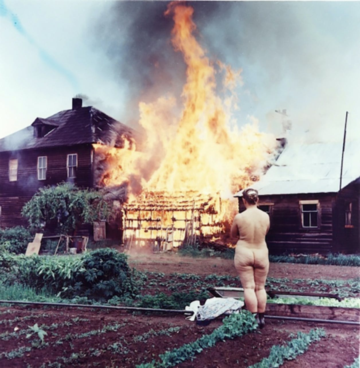 In June 1962, a Freedomite woman torches her home as a protest against materialism. The Vancouver Sun.