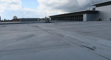 Single ply roof prior to cleaning and coating with Liquasil's DG flat roof waterproofing system
