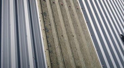 degraded GRP rooflight before cleaning
