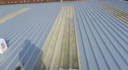 GlazeProtect GRP roof light refurbsihment coating showing part of the rooflight coated