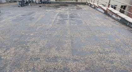 Shows the flat roof before installation of Liquasil Ultra flat roof waterproofing