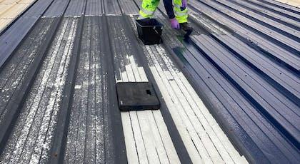 Metalseal metal roof coating being roller applied