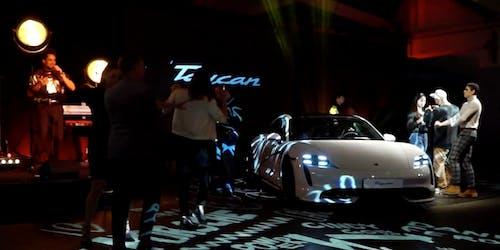 Car launch at Porsche event.