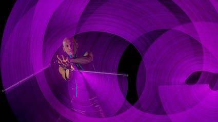 Poi-Performer creates violette circles.
