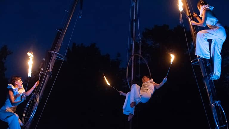Fireshow with aerial acrobatics at a public event in Berlin.