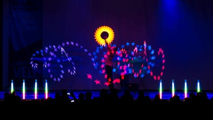Space-Light-Show with sun and stars on Corporate Event.