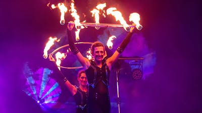 Fire artists with fire hula hoops.