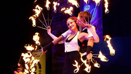 Golden twenties fire-show at city party.