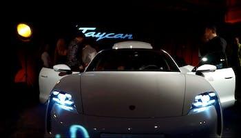 White porsche taycan at car launch.