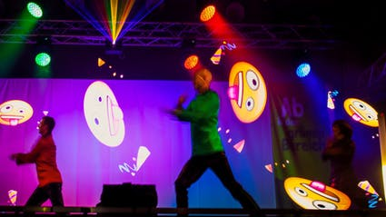 LED-Showact with three performers, who create Smiley-Logos at public event in Berlin.
