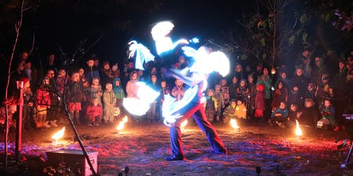 Fireartist spinning LED-Visuals at a kids event.