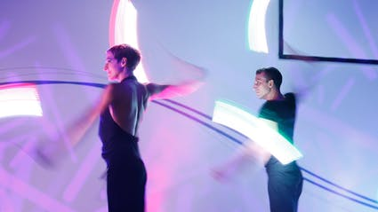 Two artists swinging LED Poi.
