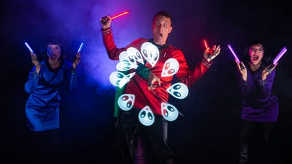 LED-Show with three performers, who create an alien-graphic.