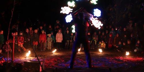 """Fire artist spins LED-Visuals from """"Sendung mit der Maus"""" at a kids event."""