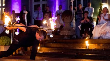 Fireshow at a wedding with a bridal couple.