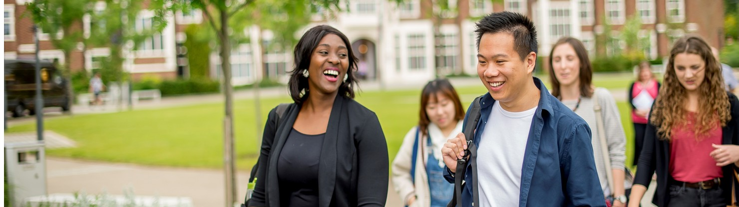 Banner image depicting two laughing people in the foreground, a woman on the left and man on the right, with people talking and laughing walking behind them.