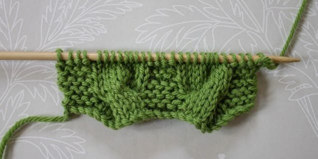 Cable knitting step 16