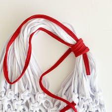 Step 23: Wrap chord around the straps