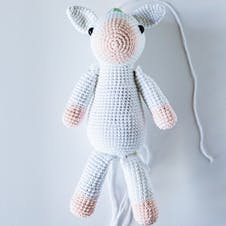 Assembling amigurumi unicorn ears, arms and legs