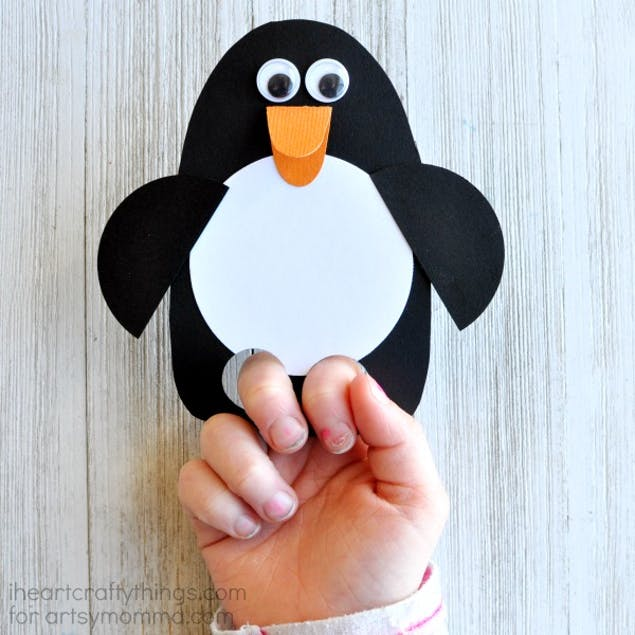 Finger puppet penguin made out of paper