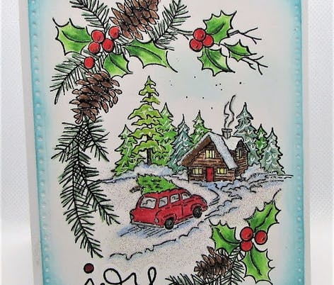 Christmas card with stamped winter cabin and car driving up to the house