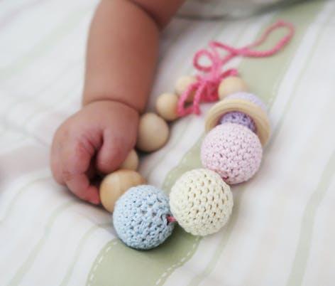 Baby play with crochet teething bracelet