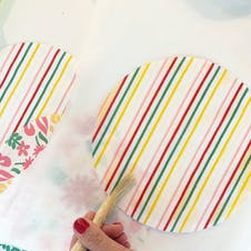 spread the beeswax across fabric with brush