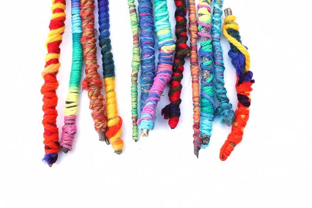 colourful yarn wrapped sticks