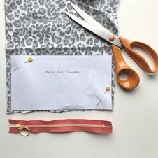 paper pattern pinned to fabric