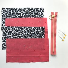 fabric rectangles, zip and pins