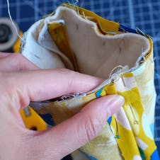 Pin bag exterior and lining together