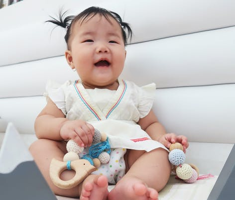 baby play with crochet beads