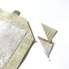 Close up of the trimmed corners of the bookmark