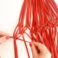 Step 12: Next row of knots