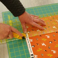 cut the fabric using rotary cutter