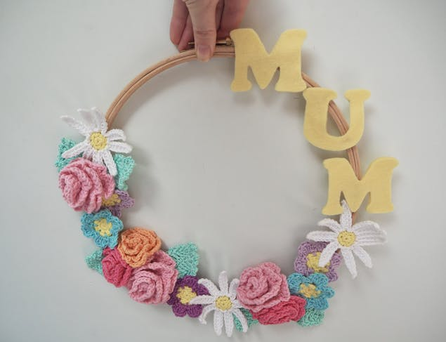Image of wreath with crochet flowers and mum word.