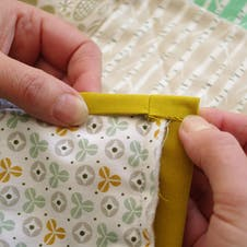 fold the edge and hand stitch