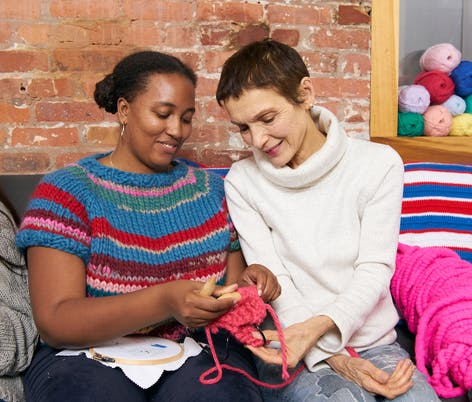 two women knitting for charity
