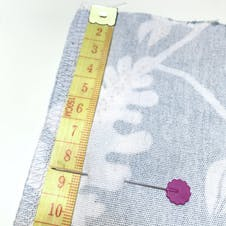 Pin marking 8cm from top of fabric