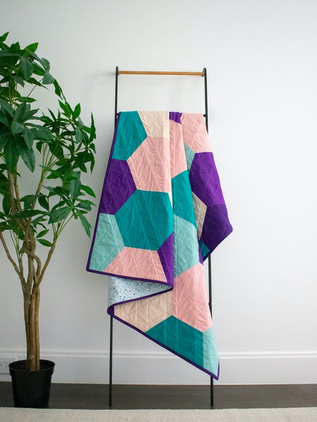 finished hexagon quilt display